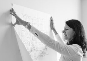 architect looking at sketch of building